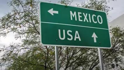 Sign that points to Mexico in one direction and USA to another
