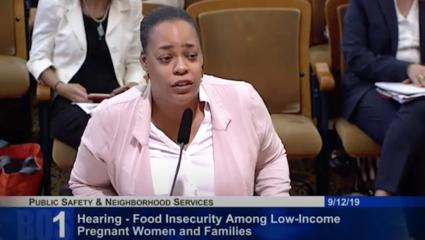 PTBi Community Engagement Specialist, Daphina Melbourne, speaking at SF City Hall at a hearing on food insecurity for low-income pregnant women and families.
