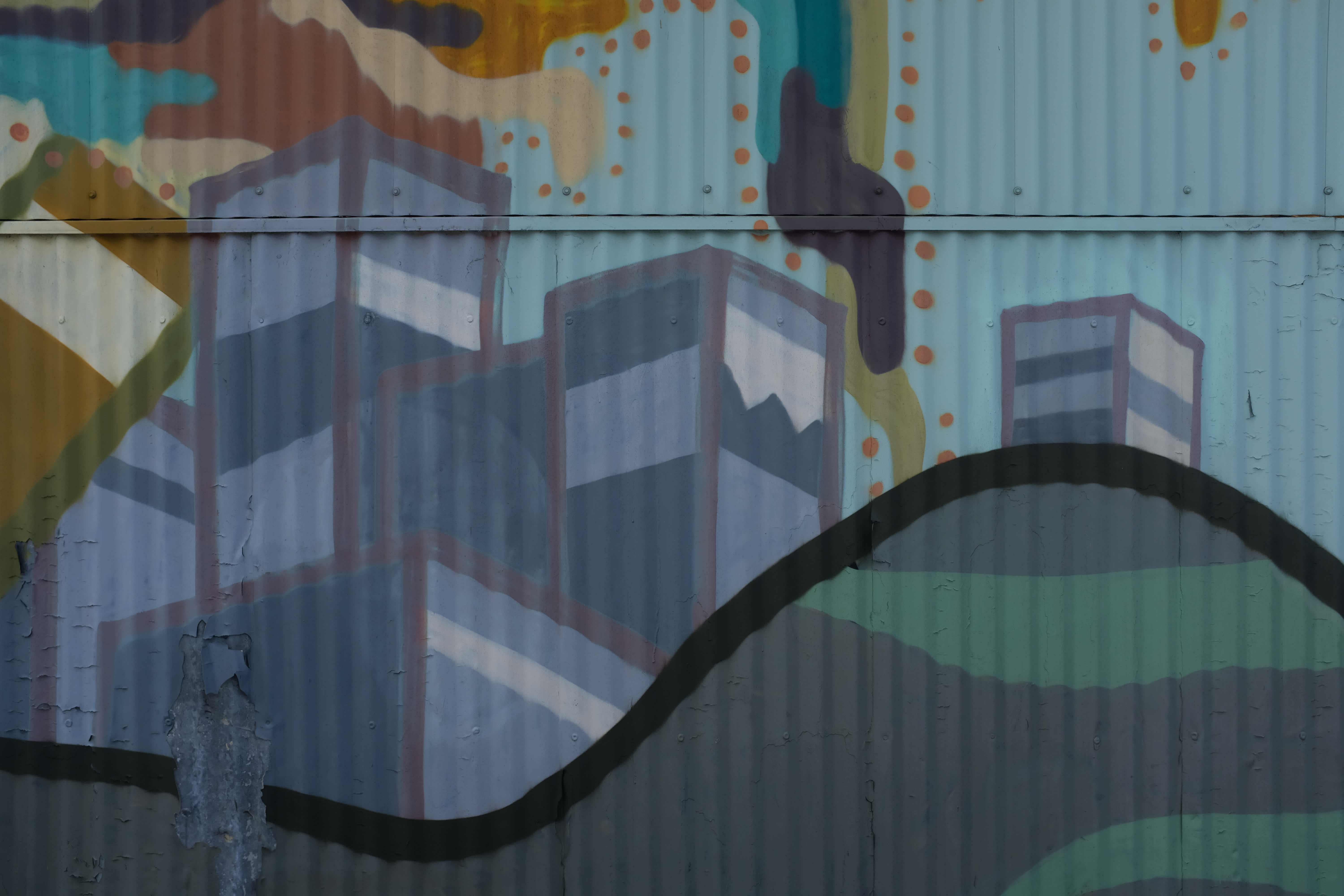 Oakland mural on aluminum paneling depicting a cityscape